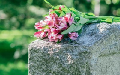 flowers resting on a gravestone