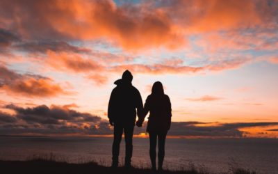 couple holding hands in sunset