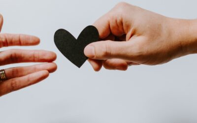 Two hands holding a paper heart | CFHP